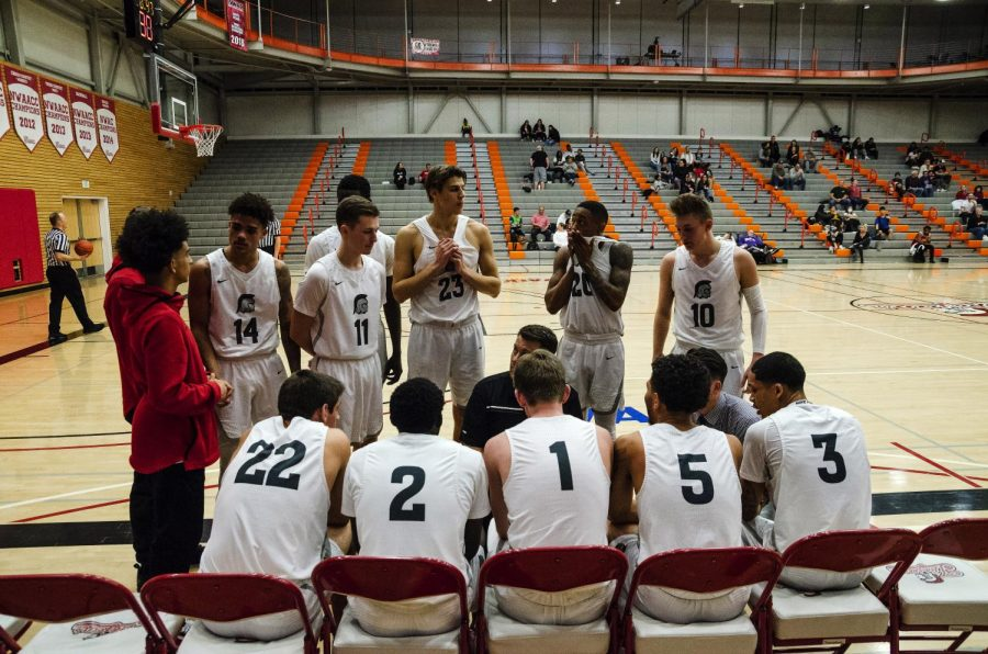 Head+Coach+Mike+Trautman+discusses++game+tactics+to+the+team+during+a+timeout+on+February+6+against+Skagit+Valley.