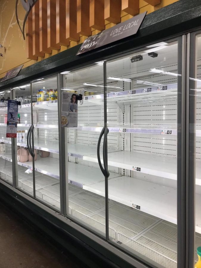 No+milk%3A+QFC+in+Redmond+has+had+its+shelves+emptied+by+worried+customers+stocking+up+before+the+winter+storm.