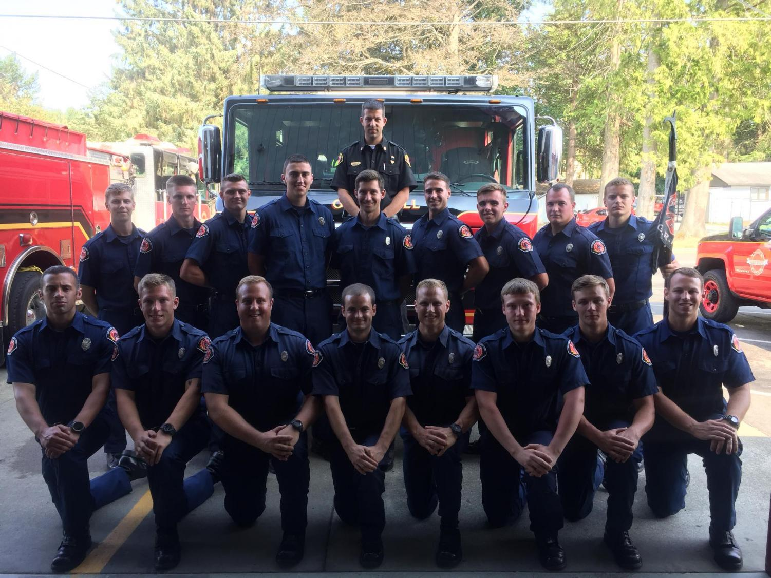 EvCC student and local volunteer firefighter, Michael Carter, (Top row, third from the right) with the 2018 GRIT recruits after completing their eight week academy.