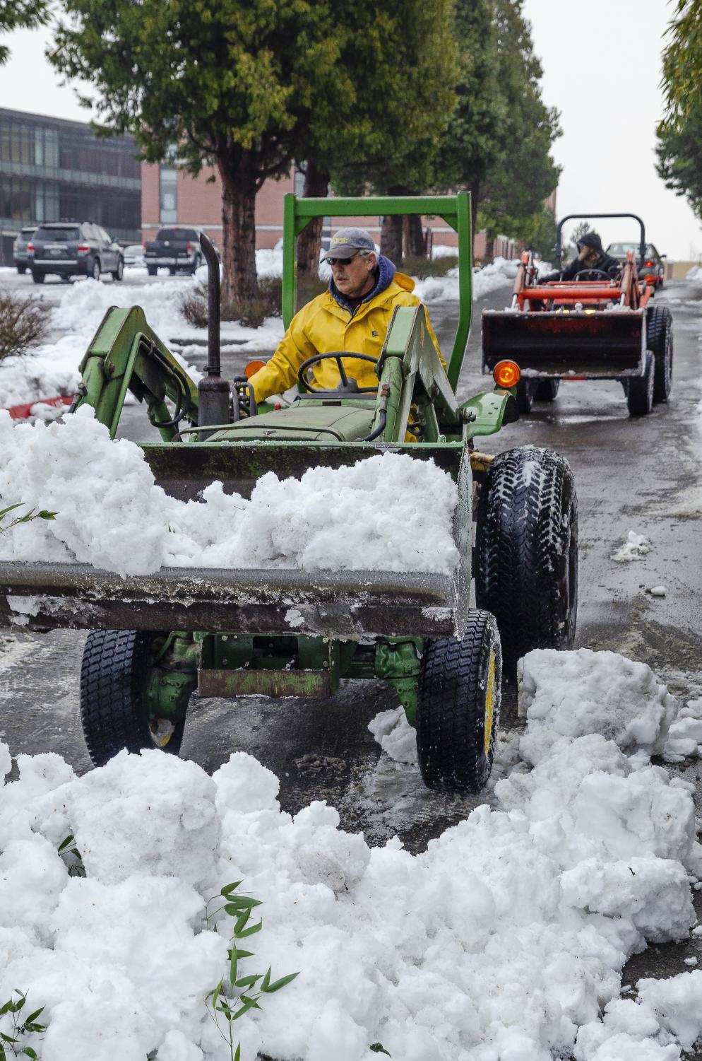 EvCC groundskeepers plow snow in various parking lots around EvCC on Wednesday, February 13.