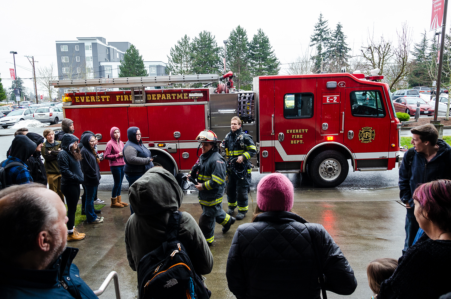 Everett firefighters responding to a smoke detector going off. Students evacuated from the building, standing outside Whitehorse Hall.