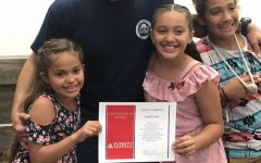 Lewis with his children at the EvCC Fire Academy graduation, Summer 2018.
