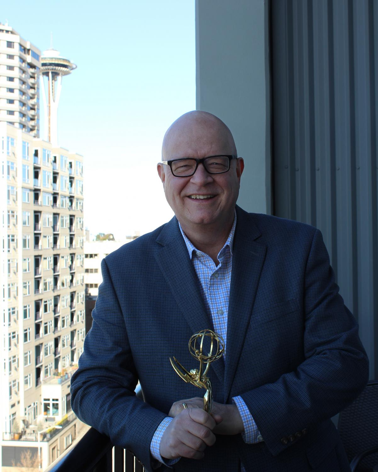 Thor Tolo, at home in Seattle, holding his Emmy from June of 1991 when he won Best Sportscaster in the Great Lake region.