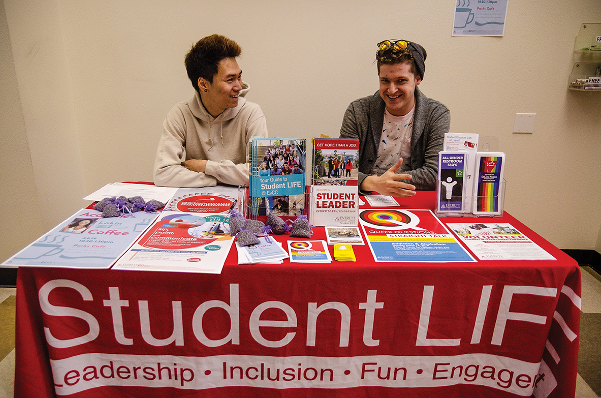 Ambassadors Cameron Calder and Ben Doung at a Student LIFE info booth providing information on services and activities for fellow students.