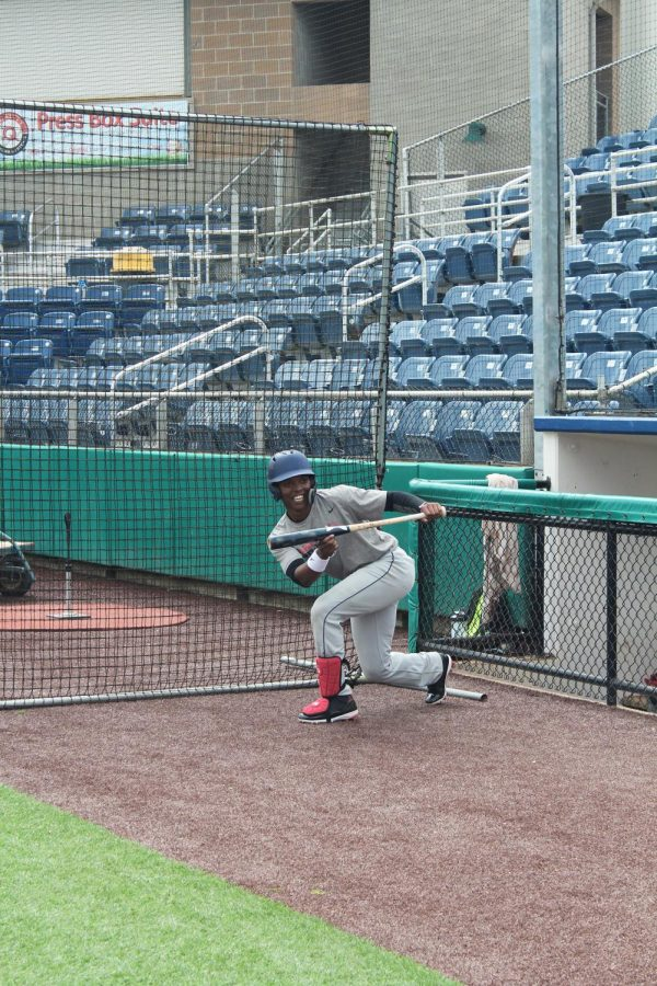 Redshirt sophomore outfielder, Davion Hollis squares up for a bunt at practice at EvCC's Funco Field in Everett.
