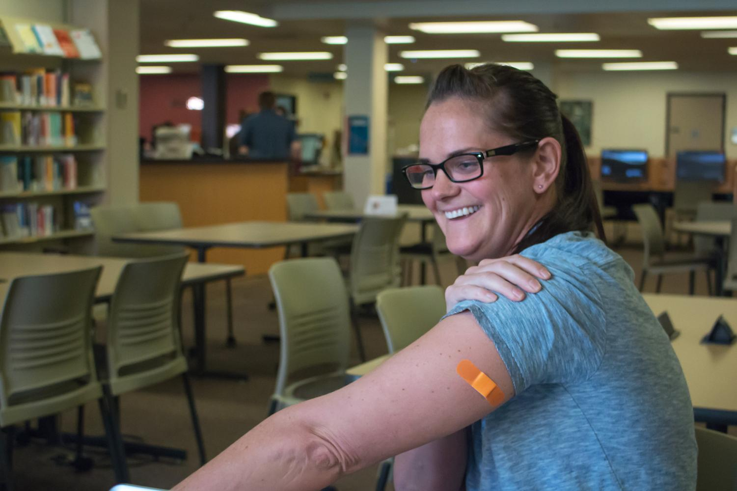 Johanna Van Dam, 34 years old, shows off her allergy shot bandage.