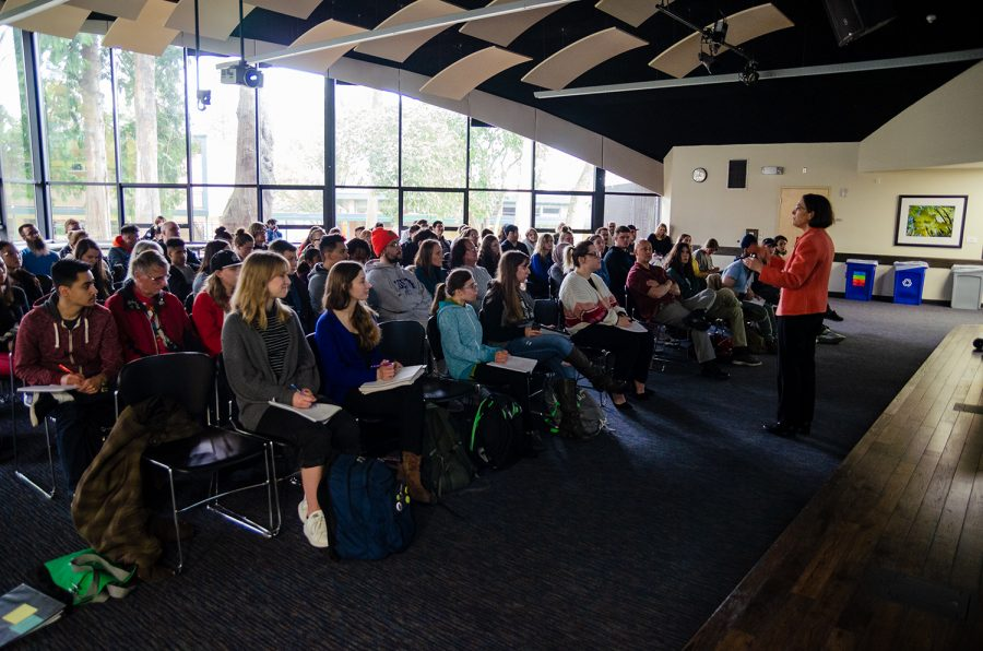 Author and speaker, Karen Treiger, delivers an impassioned speech about Holocaust survivors to a packed auditorium on Wednesday, April 17.