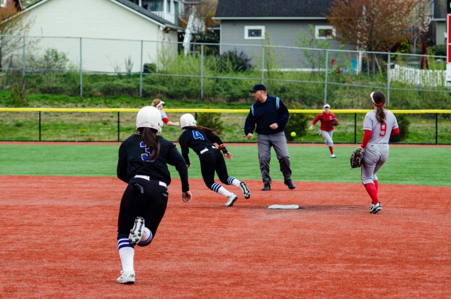 Tritons shortstop Ciena Kahui (#4) and Tritons center-fielder  Liliola Vehikite (#3)  advance base on single slapped into centerfield in top of the 6th inning of the second game of the trojans Tritons Double Header at Gaffney Field on April  12, Everett got swept in both games.