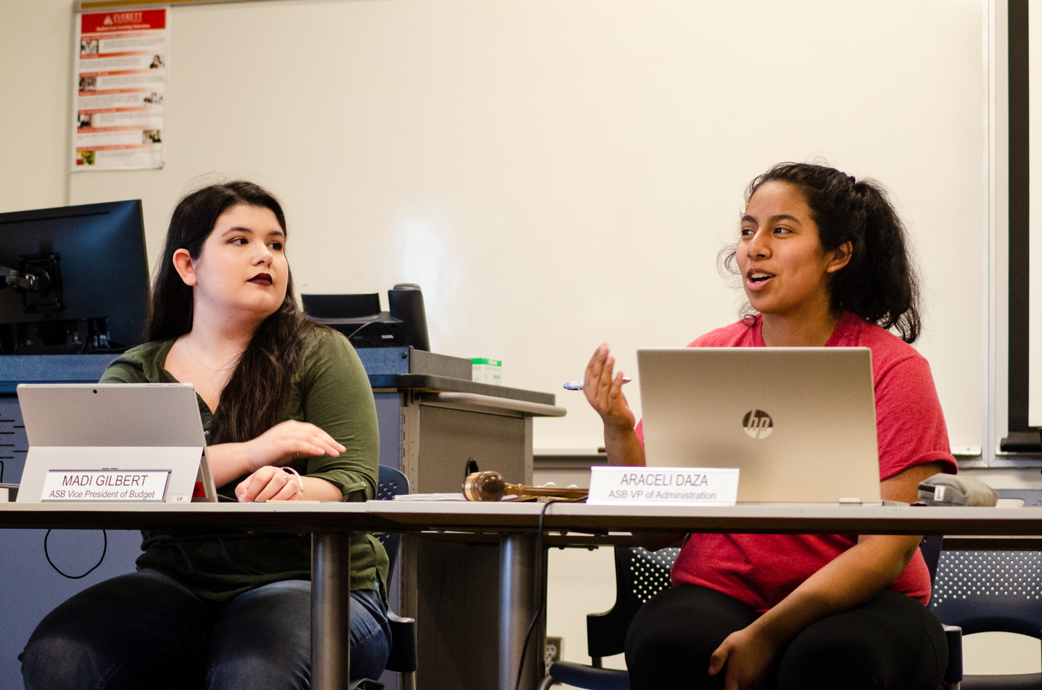 ASB VP of Budget Madison Gilbert and Vice President of Administration Araceli Daza in discussion at the ASB Senate meeting. The Senate voted unanimously to approve the budget increase, which would largely go toward raising minimum wage of student workers.