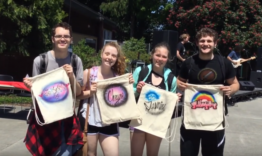 Students enjoyed a sense of community and got free things, like these custom spray-paint canvas bags at EvCC's Spring Fling Carnival on May 23, 2019.