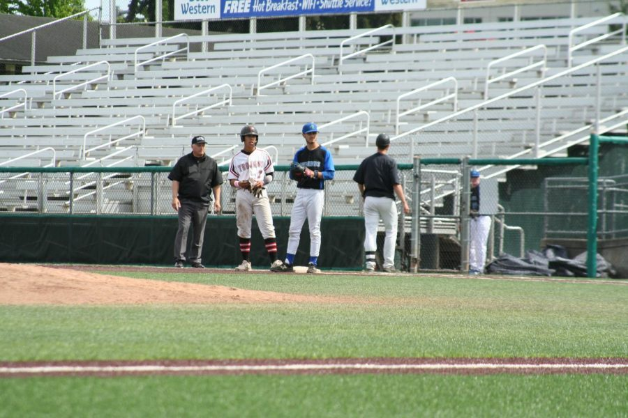 Kyle Rodriguez (EvCC in white #7) reaches first base safely in a doubleheader against Edmonds on May 13 at Funko Field.  Everett and Edmond would split the series with Everett winning  the first game 3-2 before losing the second game 6-1.