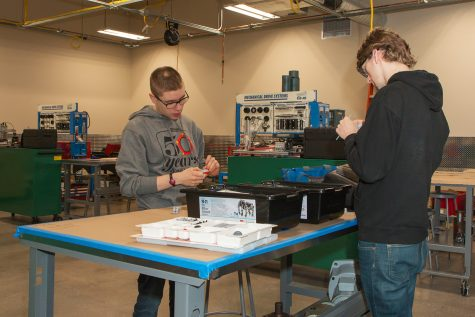 Students Connor Crowley (left) and Bennet Svob (right), work on a project using Legos in a mechanical electronics class at EvCC's Advanced Manufacturing Training and Education Center (AMTEC).