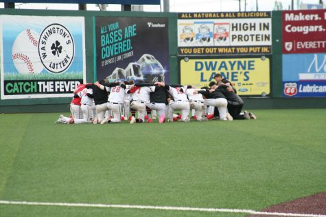 The Trojan baseball team comes together in a huddle before a regular season double header played at Funko Field. Despite winning an NWAC North  Division Title for a third consecutive season and making a third appearance to a final in the last four years, the Trojans couldn't overcome Lower Columbia in the NWAC Baseball Championships, finishing as runners-up in the tournament.