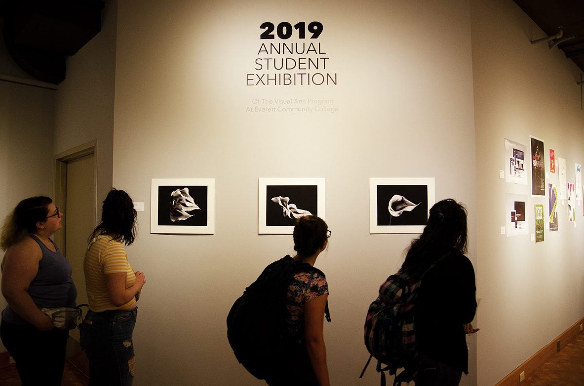 """Stacie S. McCartan, who is Managing Editor of Visuals for The Clipper, has five pieces featured in the exhibit. Her series, """"Three Lilies Triptych,"""" is featured at the entry to the gallery."""
