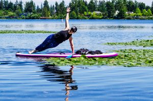 Keely Maroney, a yoga instructor, practicing stand up paddleboarding (SUP) yoga on Silver Lake.