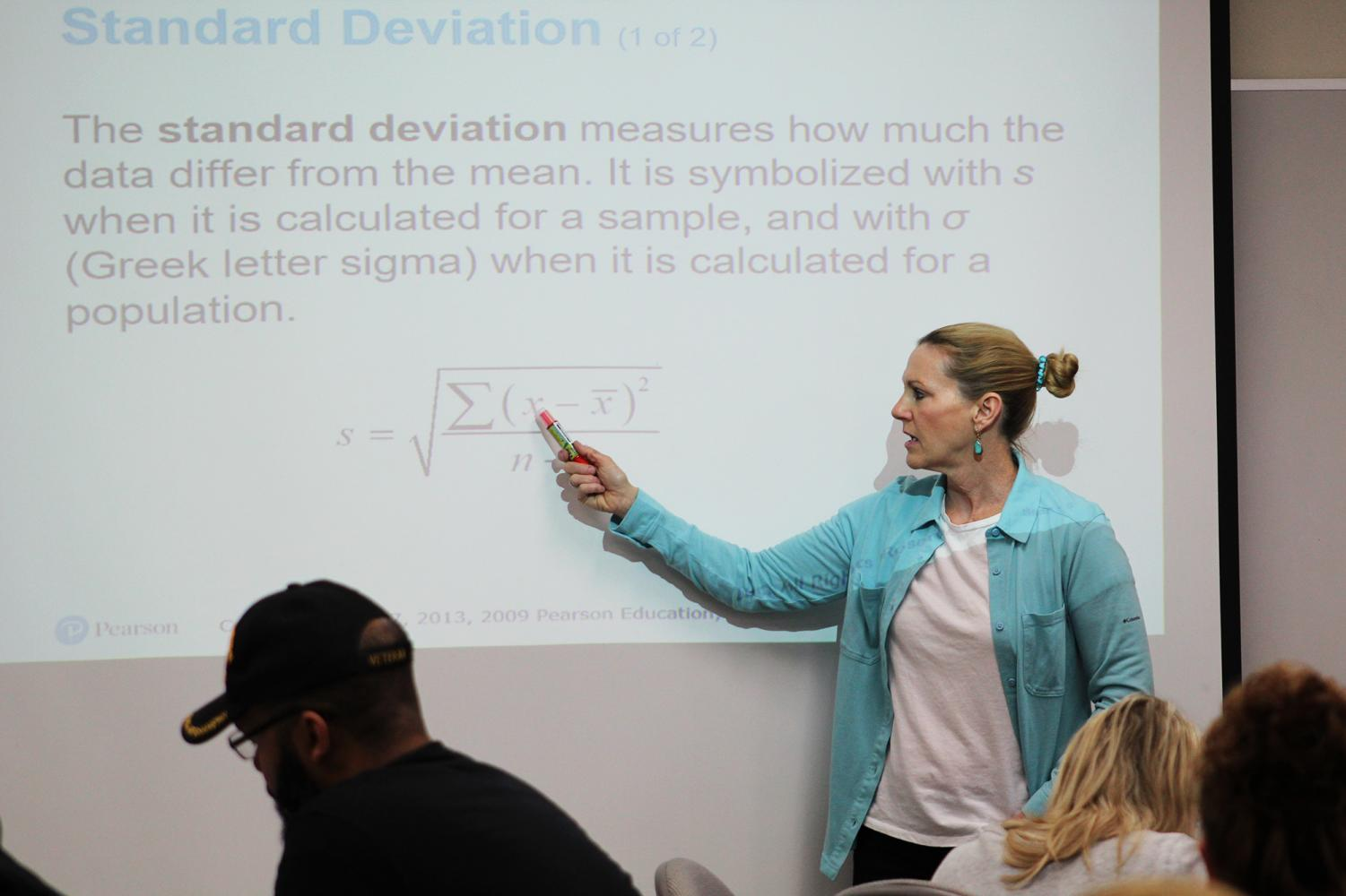 """Debby Casson during math class. """"I always start my class with fun music to get everyone psyched up and make math as fun as possible."""""""
