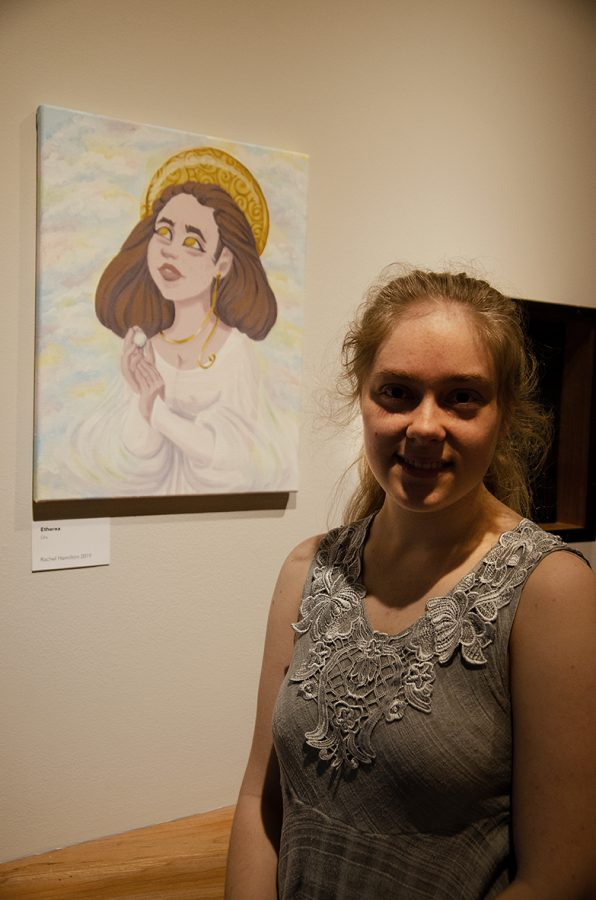 Art student Rachel Hamilton pictured with her oil painting titled,