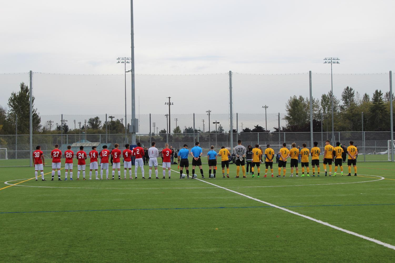 EvCC men's soccer team   line up to begin a match against Shoreline.