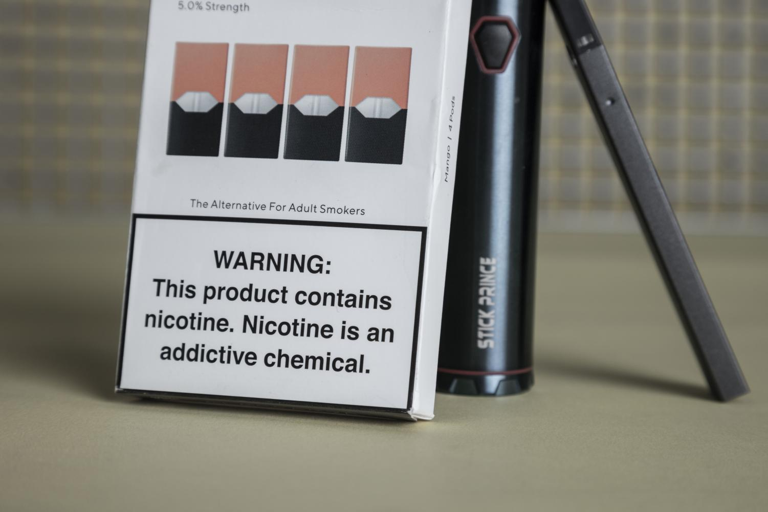 Juul packaging warns about the dangers of nicotine.