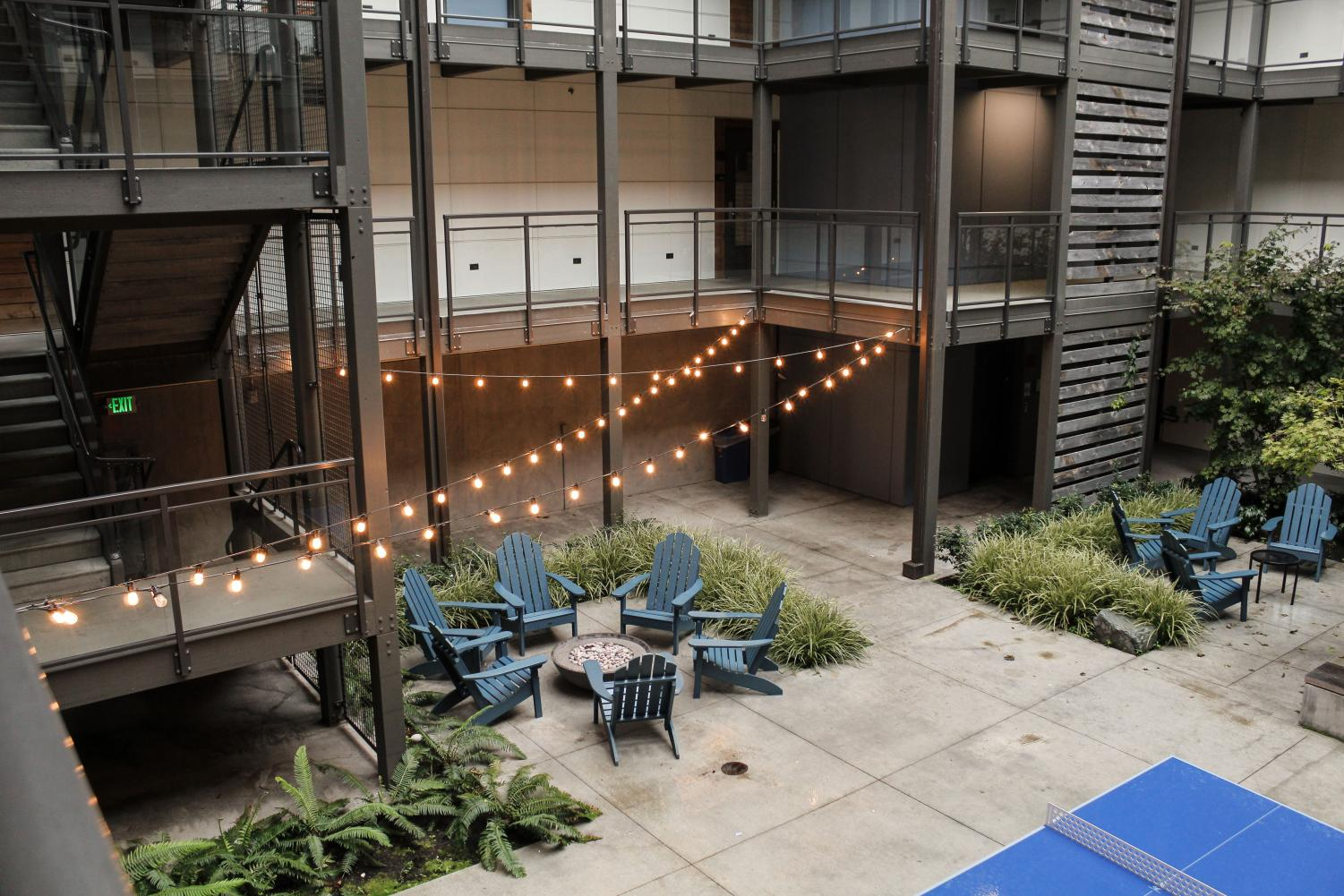 Courtyard at Cedar Hall dorm including ping-pong tables and fire pits.