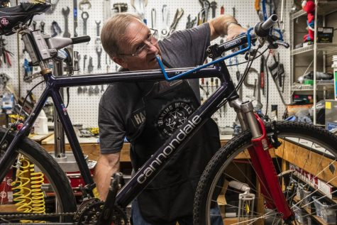 David Fox, a volunteer at Sharing Wheels working on a bike.
