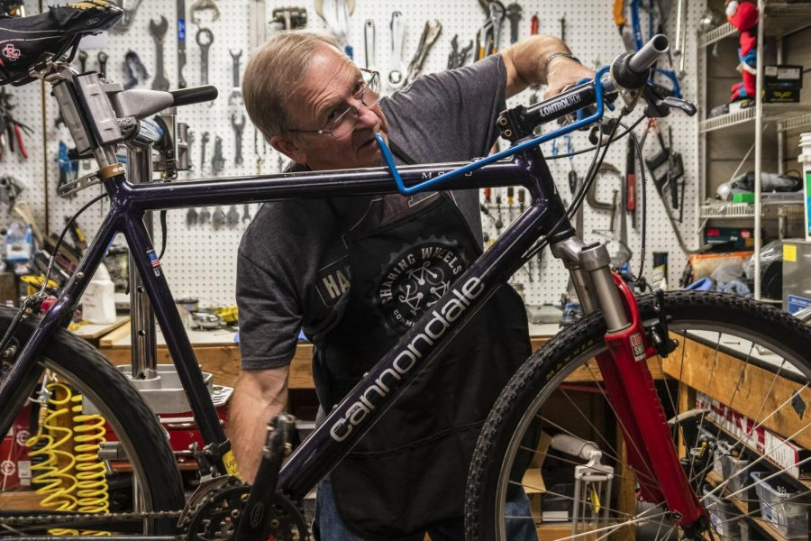 David Fox, a volunteer at Sharing Wheels working on a bike.