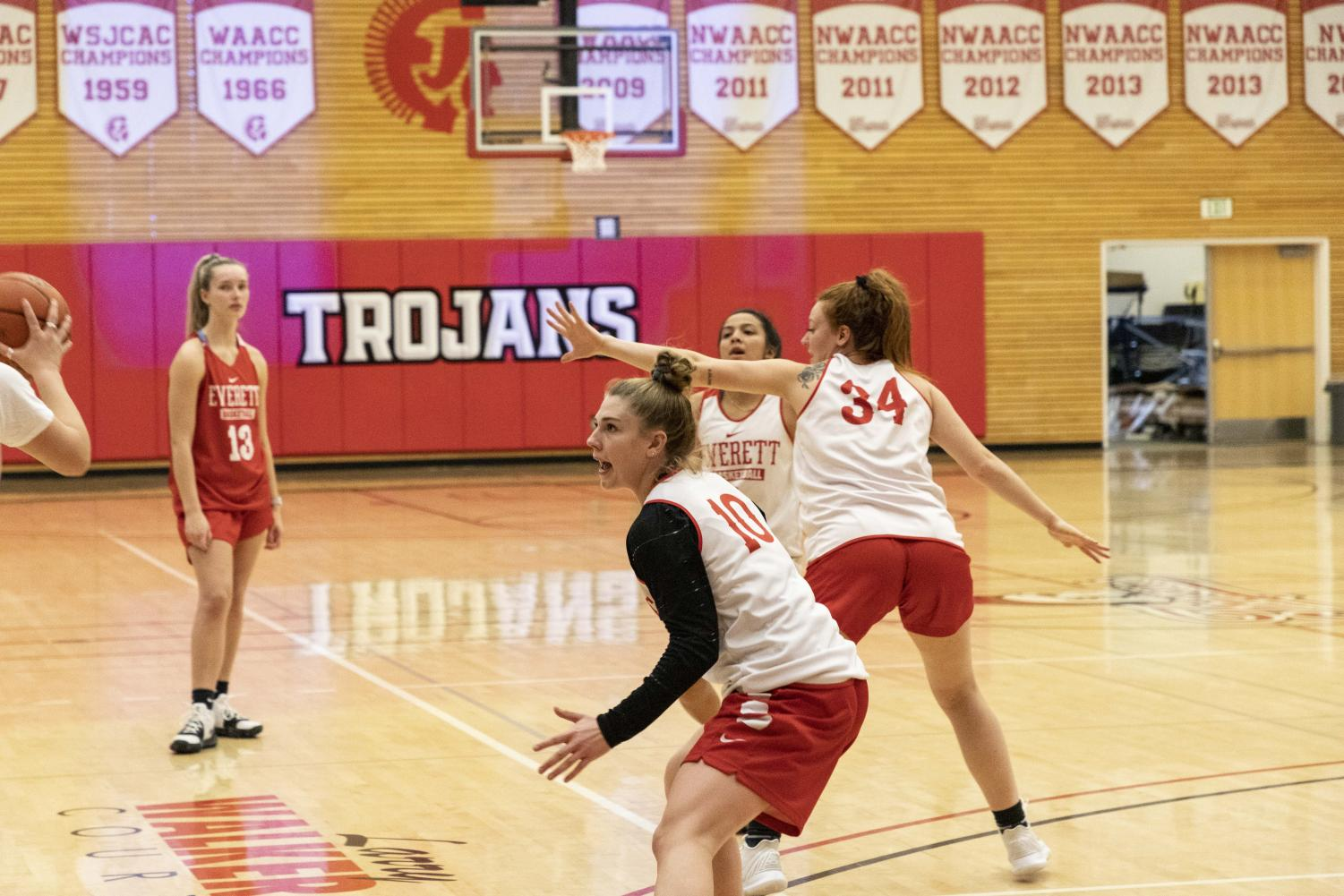 Sophomores Morgan Marshall (#10) and Kelsey Mellick ( #34) take part in a  defensive drill during a practice at the Walt Price Fitness Center.