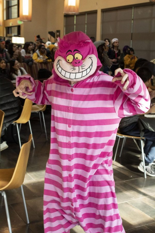 Student, Ray Walker, dressed as the Cheshire Cat from Alice in Wonderland.