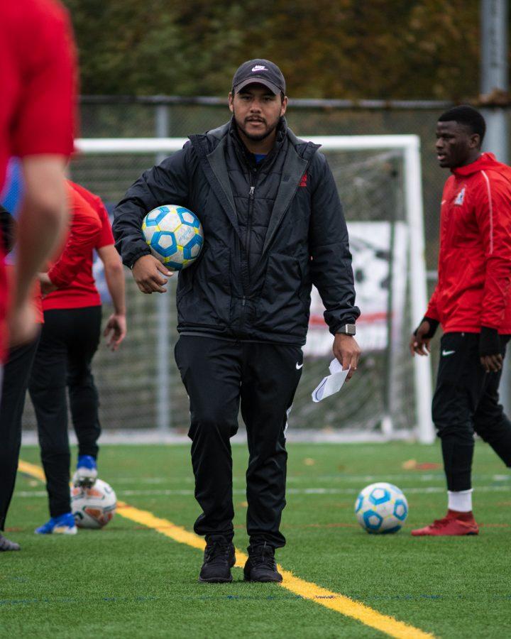 Erik Cruz, on the field at Kasch Park, coaching the EvCC Men's soccer team.