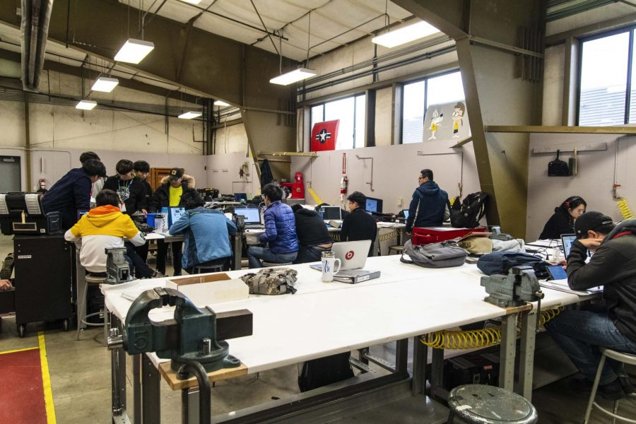 EvCC AMT students gather around a table doing projects for their assigned courses located at Snohomish County Airport on Monday Nov. 4.