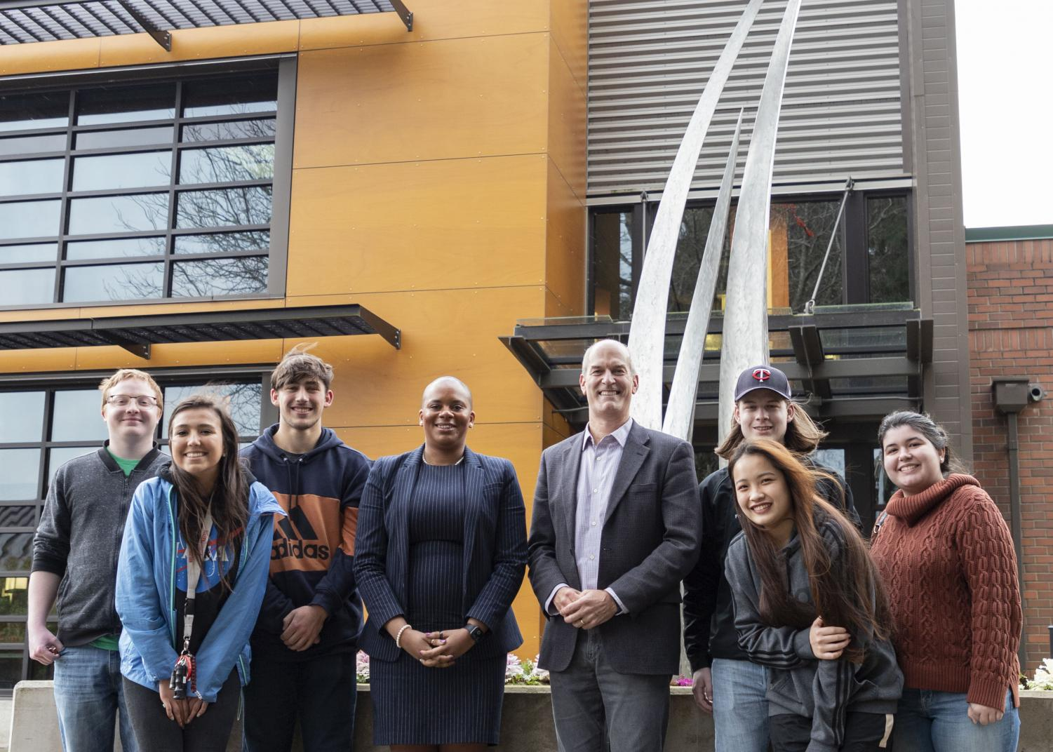 Congressman Rick Larsen  (Middle) stands next to President Willis (Left) and members of ASB in front of the Feather Star outside of the Parks Student Union after meeting to discuss Open Educational Resources, textbook prices and food insecurity on Tuesday Jan. 21.