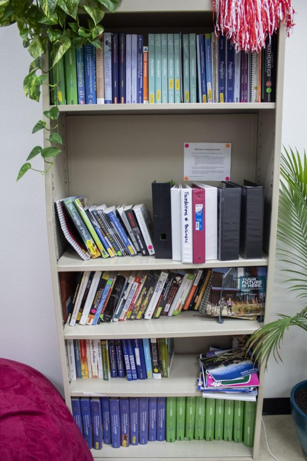 A+bookcase+of+materials+inside+the+TRiO+office%2C+located+in+Monte+Cristo+Hall.