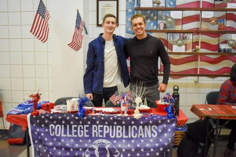EvCC Republican Club President Josiah Reiser (left) and treasurer Sasha Phillips (right) at Winter Club Fest on Jan. 30.