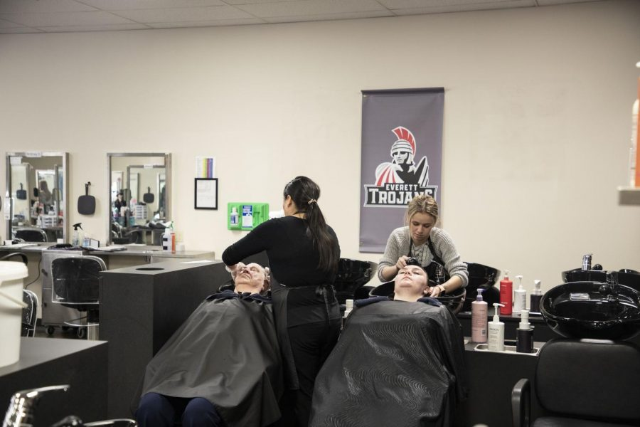 EvCC cosmetology students practicing working with hair.