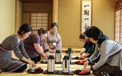 Tea students practice chado under tea master Masaye Nakagawa at the tea room adjoined to the Nippon Business Institute on Feb. 26.