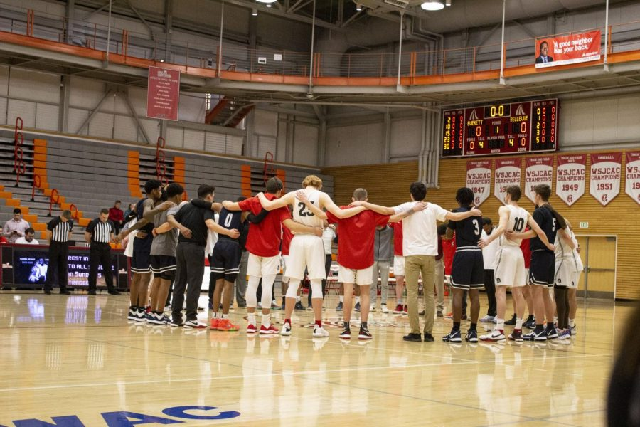 EvCC men's basketball team, huddled together for a moment of silence in honor of Kobe Bryant.