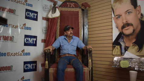 Joe Exotic, sitting on a throne next to a portrait of himself. According to Joe, his Garold Wayne Exotic Memorial Park in Oklahoma held 176 tigers in captivity.