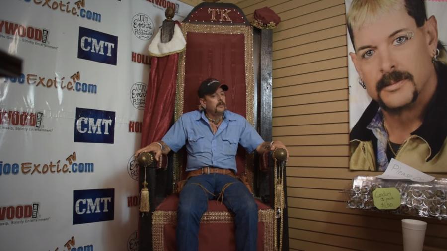 Joe+Exotic%2C+sitting+on+a+throne+next+to+a+portrait+of+himself.+According+to+Joe%2C+his+Garold+Wayne+Exotic+Memorial+Park+in+Oklahoma+held+176+tigers+in+captivity.++