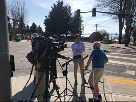 John clutches his walker while speaking with KCPQ-TV Q13 Fox reporter AJ Janavel about witnessing the shooting on the corner of Rucker and Everett Ave in Everett on Thursday April 9, 2020.