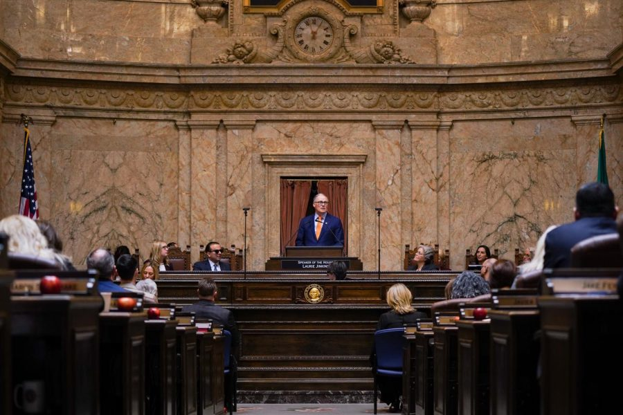 Washington State Gov. Jay Inslee signs new COVID-19 order to slowly reopen the states economy. This photo was taken at the 2020 State of the State Address on Tuesday, Jan. 14, 2020 at the Washington State Capital Building in Olympia.