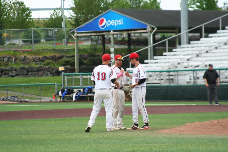 """EvCC baseball players fist-bumping at a game held in May of 2019. According to an official NWAC announcement from Mar. 18, 2020, """"It is our desire to do our part to limit the spread of the COVID-19 virus in the interest of the health and well-being of our student-athletes….,"""" in regards to the cancelation of all spring sports competitions."""