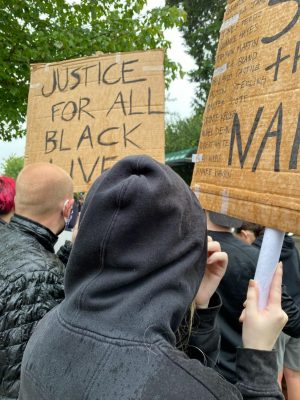 "On Jun. 2, protesters in Mill Creek chanted ""Black lives matter"" while holding signs that said ""Justice For All Black Lives"" and ""Say Their Names""."