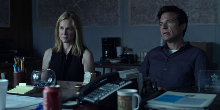 Wendy (left) and Marty (right) Byrde, played by Laura Linney and Jason Bateman, meet with local law enforcement. The police are onto the Byrdes as soon as they arrive in the Ozarks.