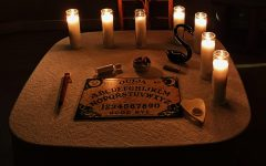 Séances are believed to be most effective in the dark, with candles an only source of light.