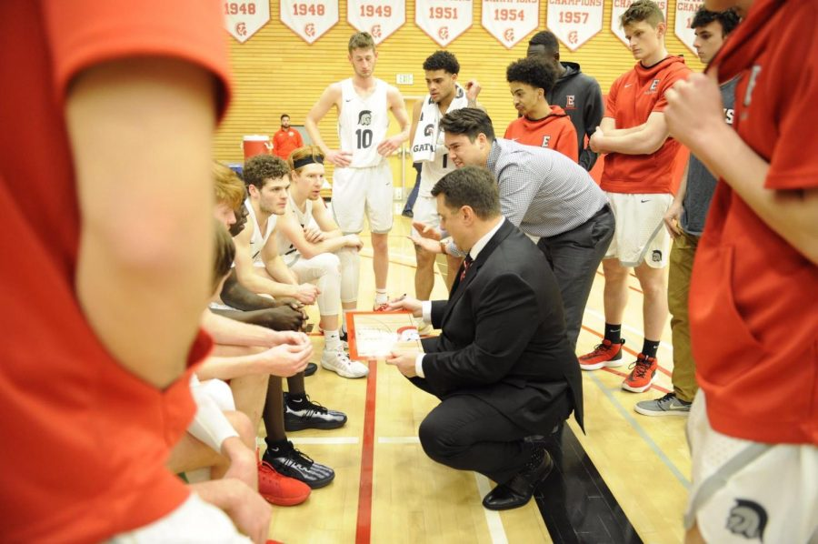 Coach Mike Trautman discussing tactics with his team during a break in the game against Edmonds CC Tritons on January 15, 2020.