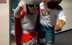 Trojan (EvCC mascot) and Lincoln (Silvertips Mascot) pose for a photo together.