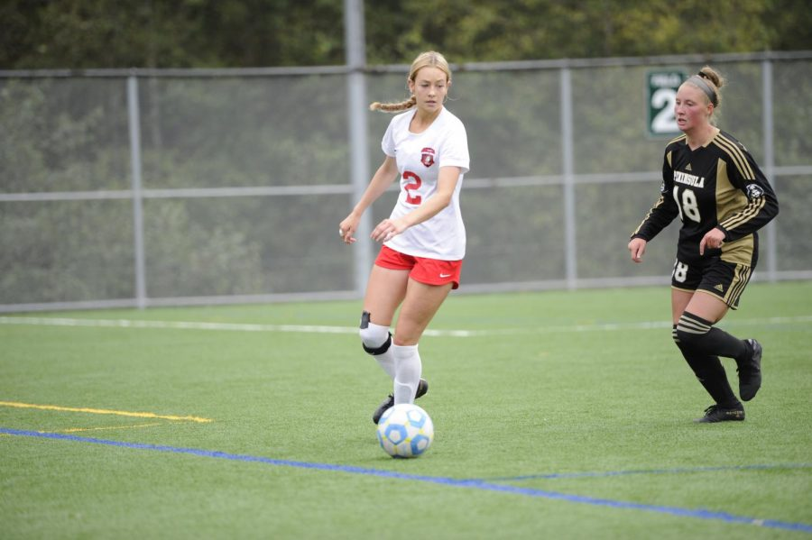 Womens+Soccer+Team+Captain+Emily+Marriot+dribbling+the+ball+in+a+game+on+Sept.+21%2C+2019+against+Peninsula+Pirates.