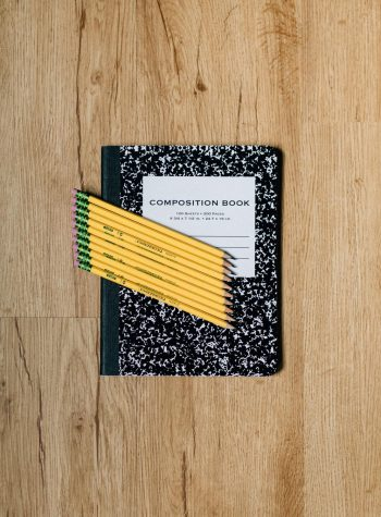 Composition notebook and pencils.