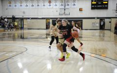 Freshman Guard Sydney VanNess (#24) driving to the basket against Peninsula CC on April 3, 2021.